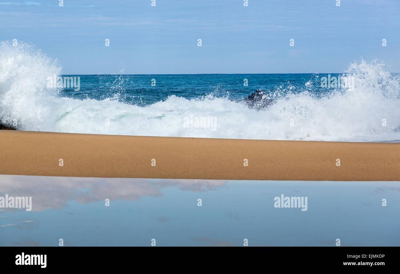 Waves crash onto Lumahai beach on Kauai Hawaii - Stock Image