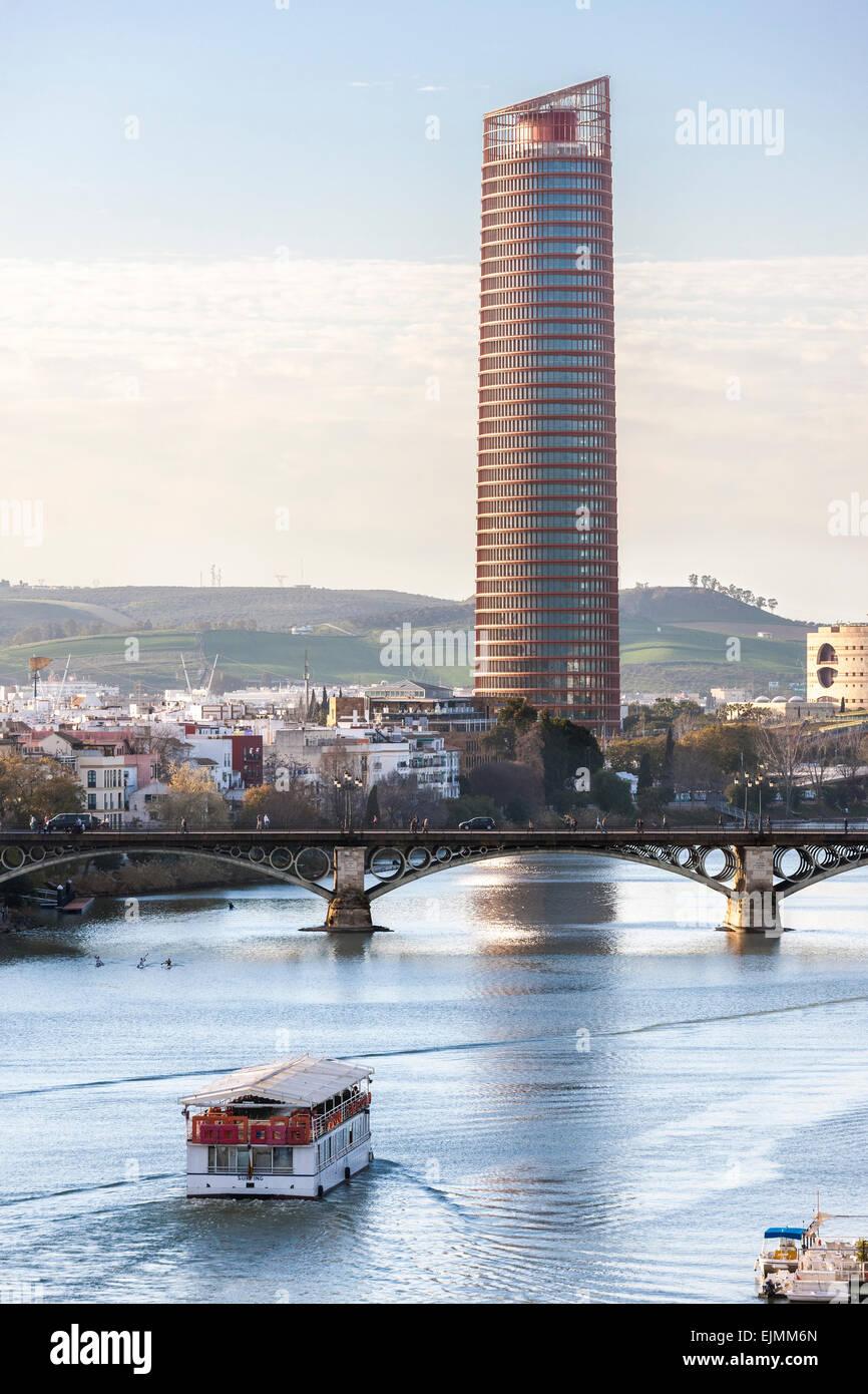 Torre Cajasol Tower Seville Spain office skyscraper high rise building on Guadalquivir River with Puente de Isabel - Stock Image