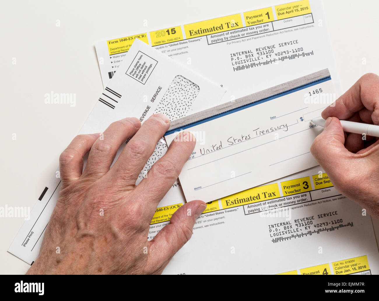 Male Caucasian Hands Writing Check To Internal Revenue Service Irs