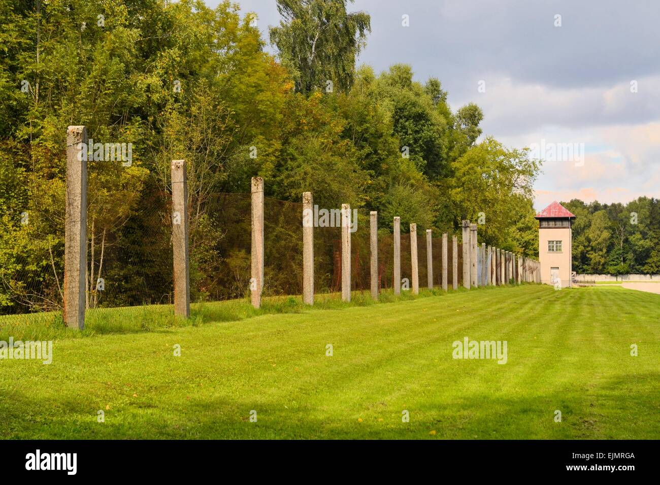 Fence and watch tower at Dachau concentration camp - Stock Image