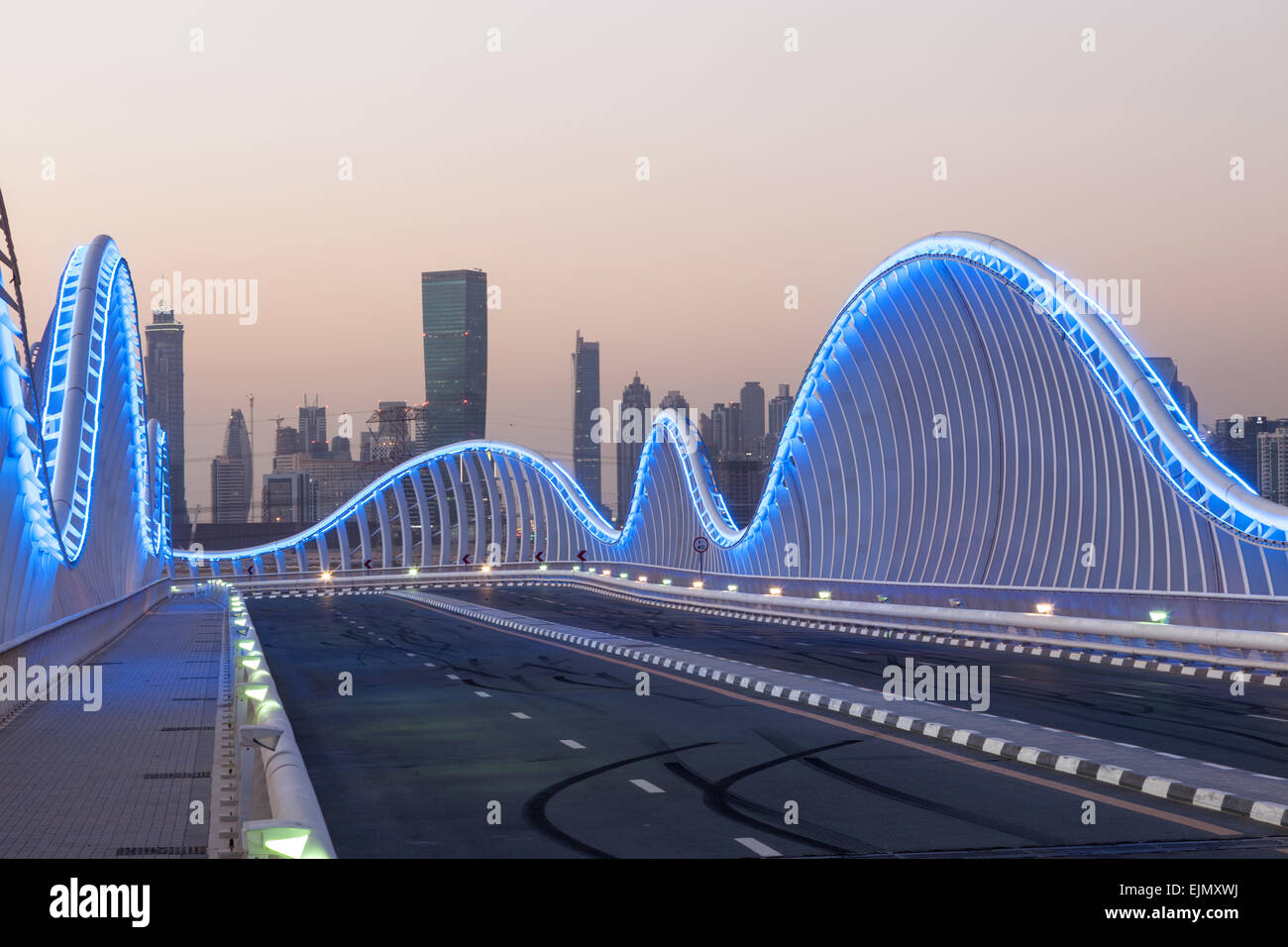 Wave shaped Meydan Bridge in Dubai illuminated at night. December 13, 2014 in Dubai, United Arab Emirates - Stock Image