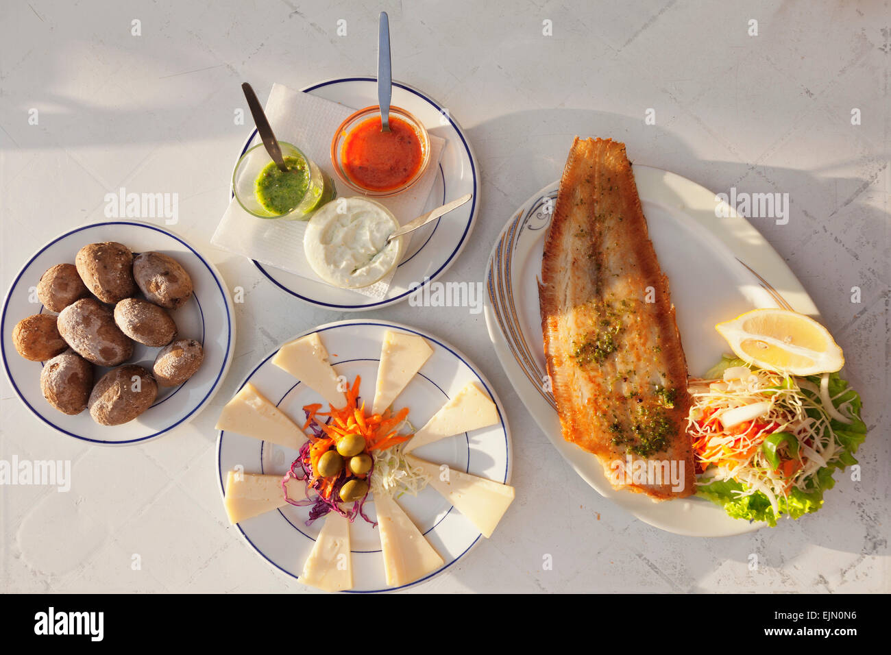 Papas arrugadas con mojo, wrinkled potatoes with mojo sauce, fried fish and cheese platter with Canarian cheese, - Stock Image