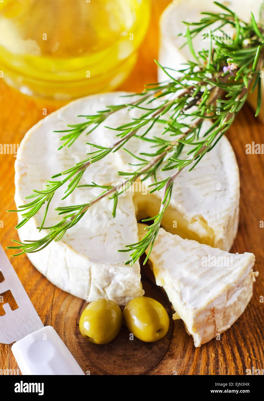 Italian cheese with olives and rosemary Stock Photo