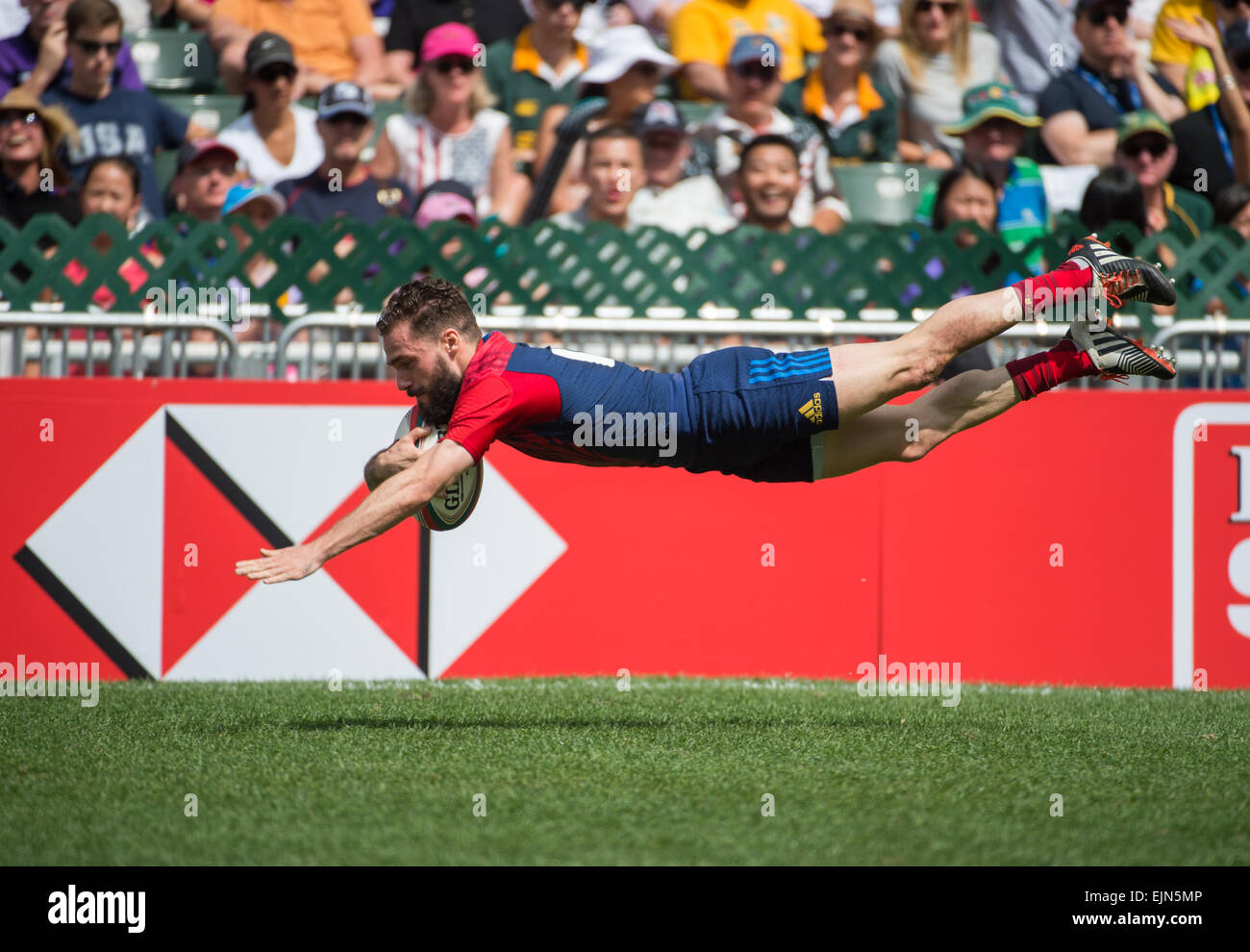 Hong Kong, China. 28th Mar, 2015. Terry Bouhraoua of France flies down the wing to score a try virtually unhindered.France Stock Photo