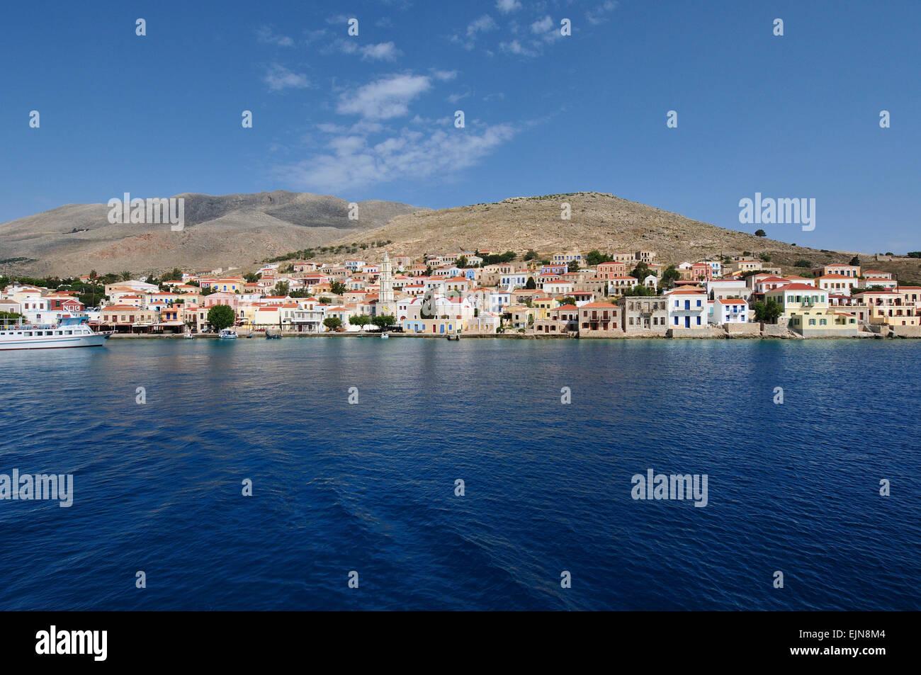 Halki. Greece. View of the port village Emporio. - Stock Image