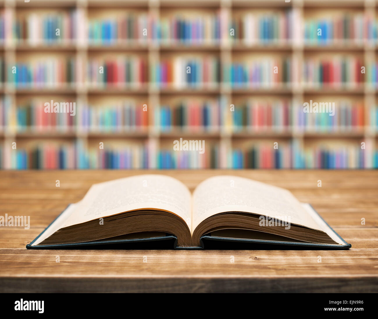 Open book on the table in shallow focus. - Stock Image