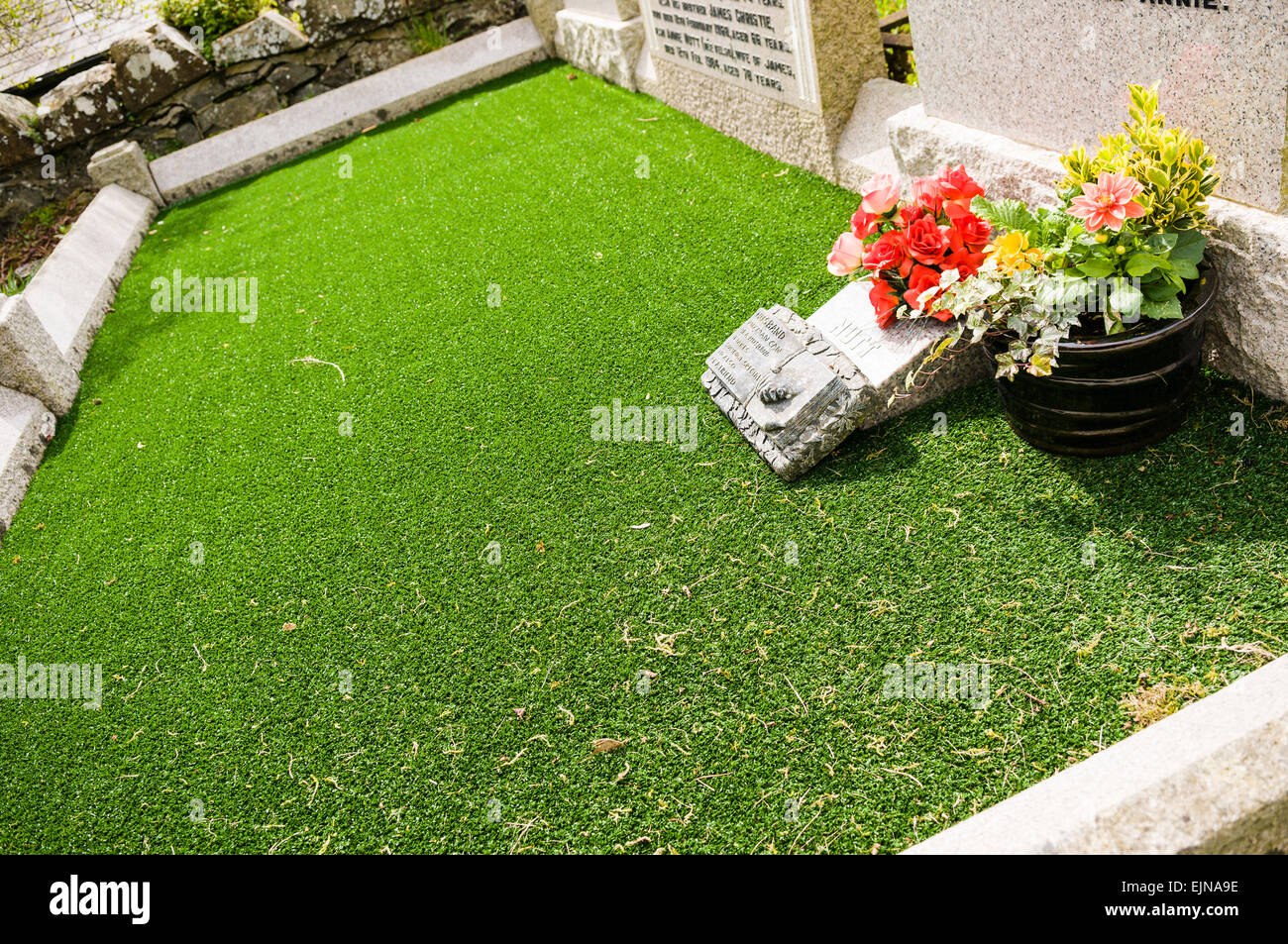 A grave fitted with astroturf Stock Photo