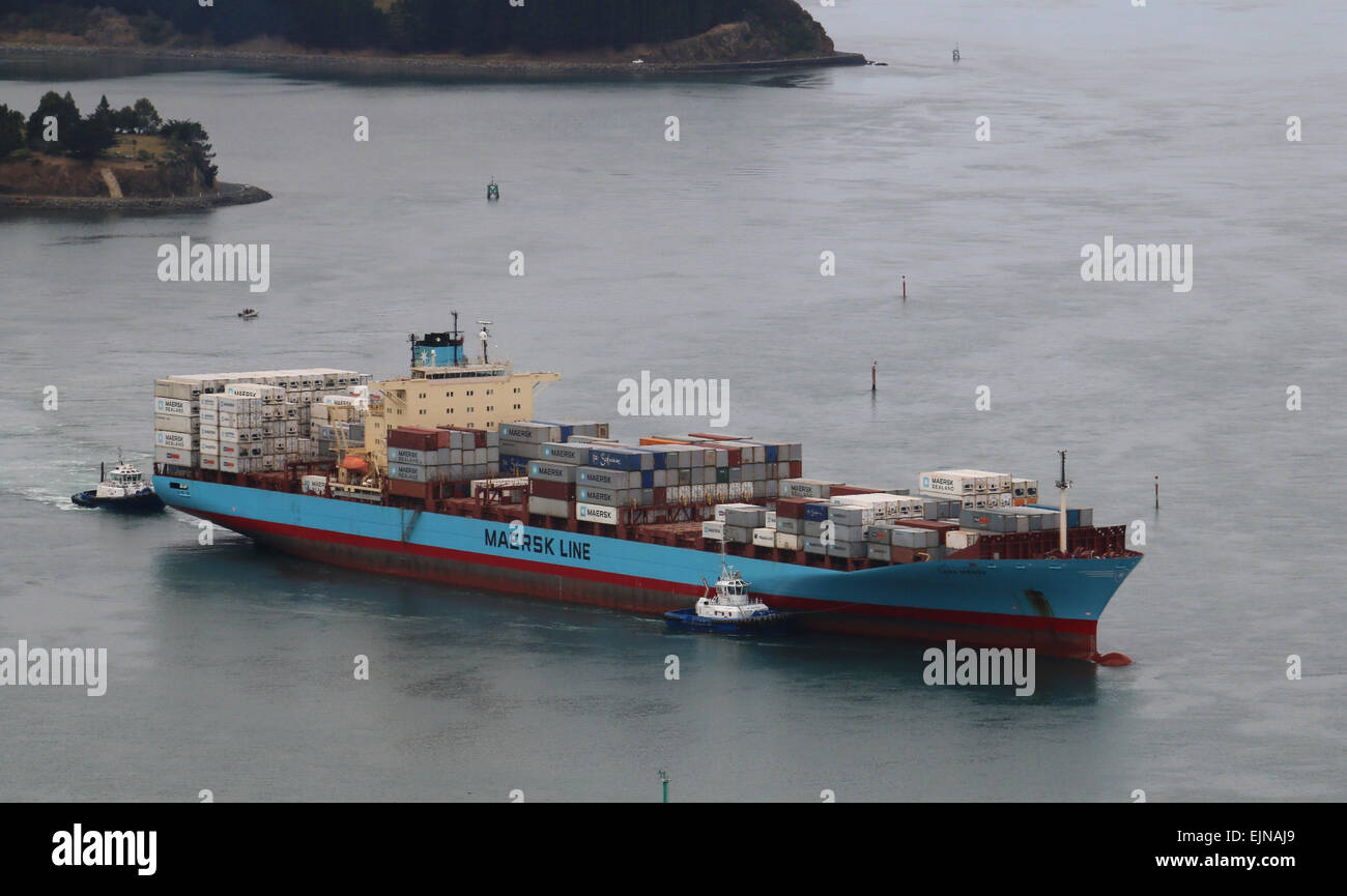 Container ship entering Port Chalmers New Zealand Otago Harbour Stock Photo