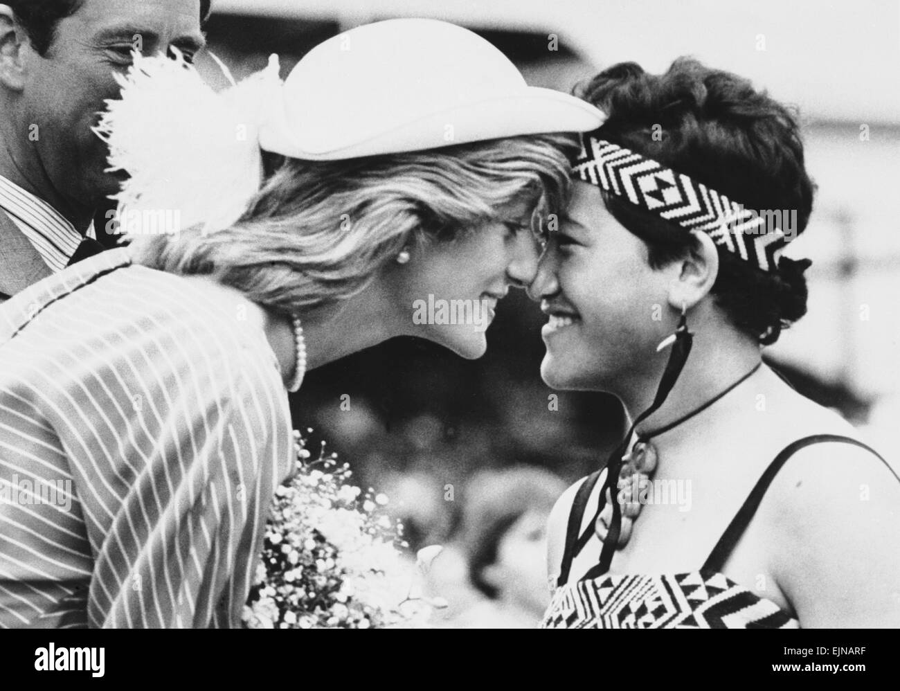 Princess Diana rubs noses with sixteen year old Maori Susan Piper as she is greeted on her arrival in Auckland, - Stock Image