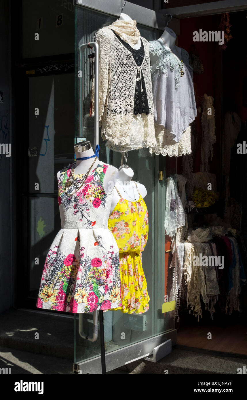 Colorful garments for sale in shop in New York City - Stock Image