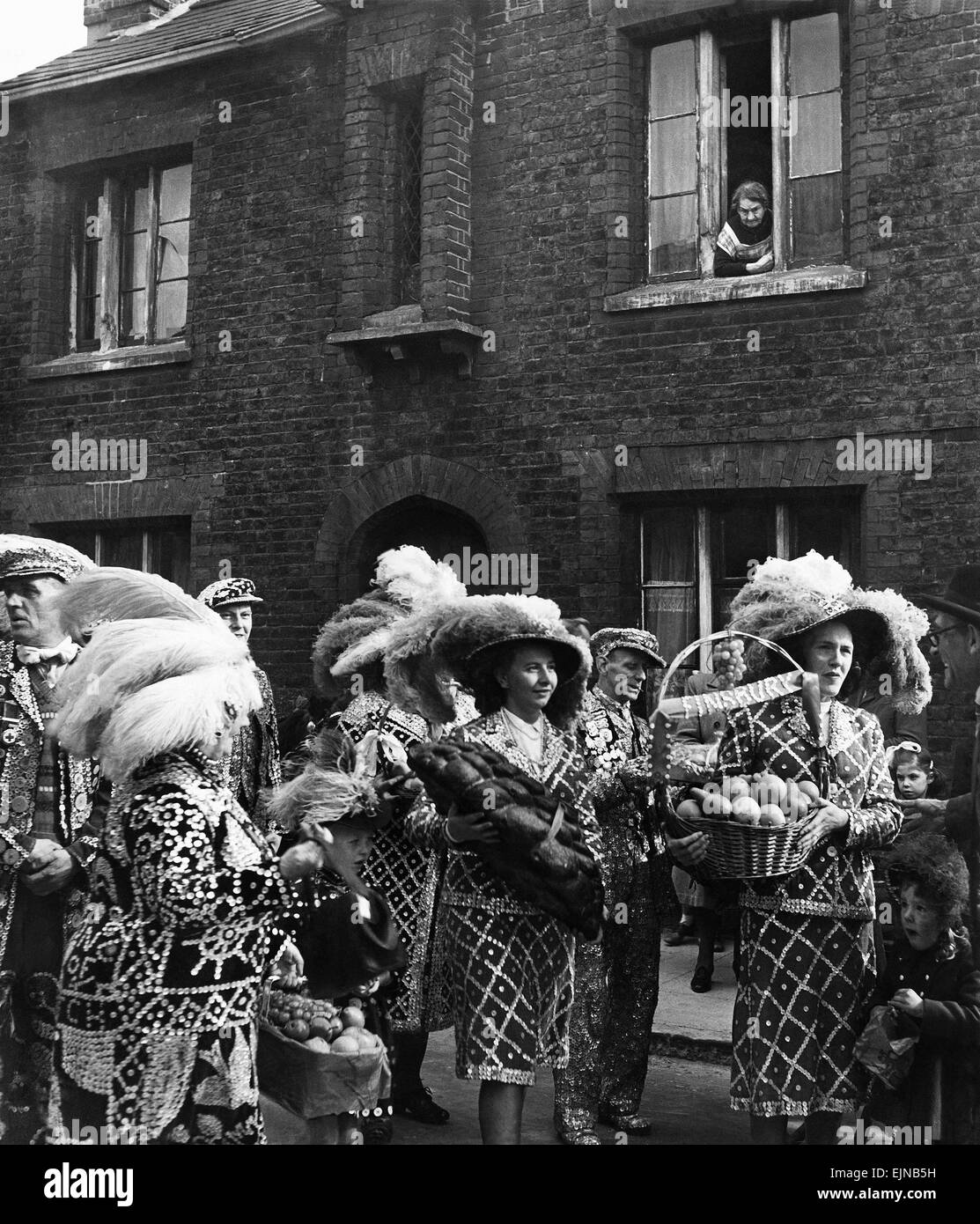 Pearly Kings and Queens arrive at St Marts Church Walworth with offerings for the 'Pearlies' Harvest Festival. - Stock Image