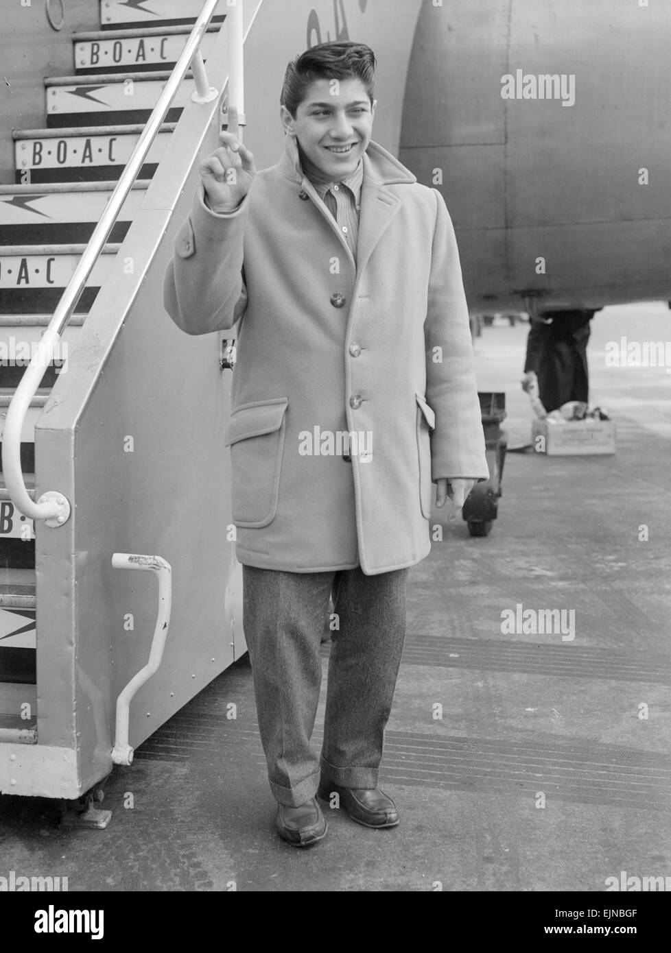 Sixteen year old Canadian singer songwriter Paul Anka pictured on his arrival in Britain. 28th February 1958. - Stock Image