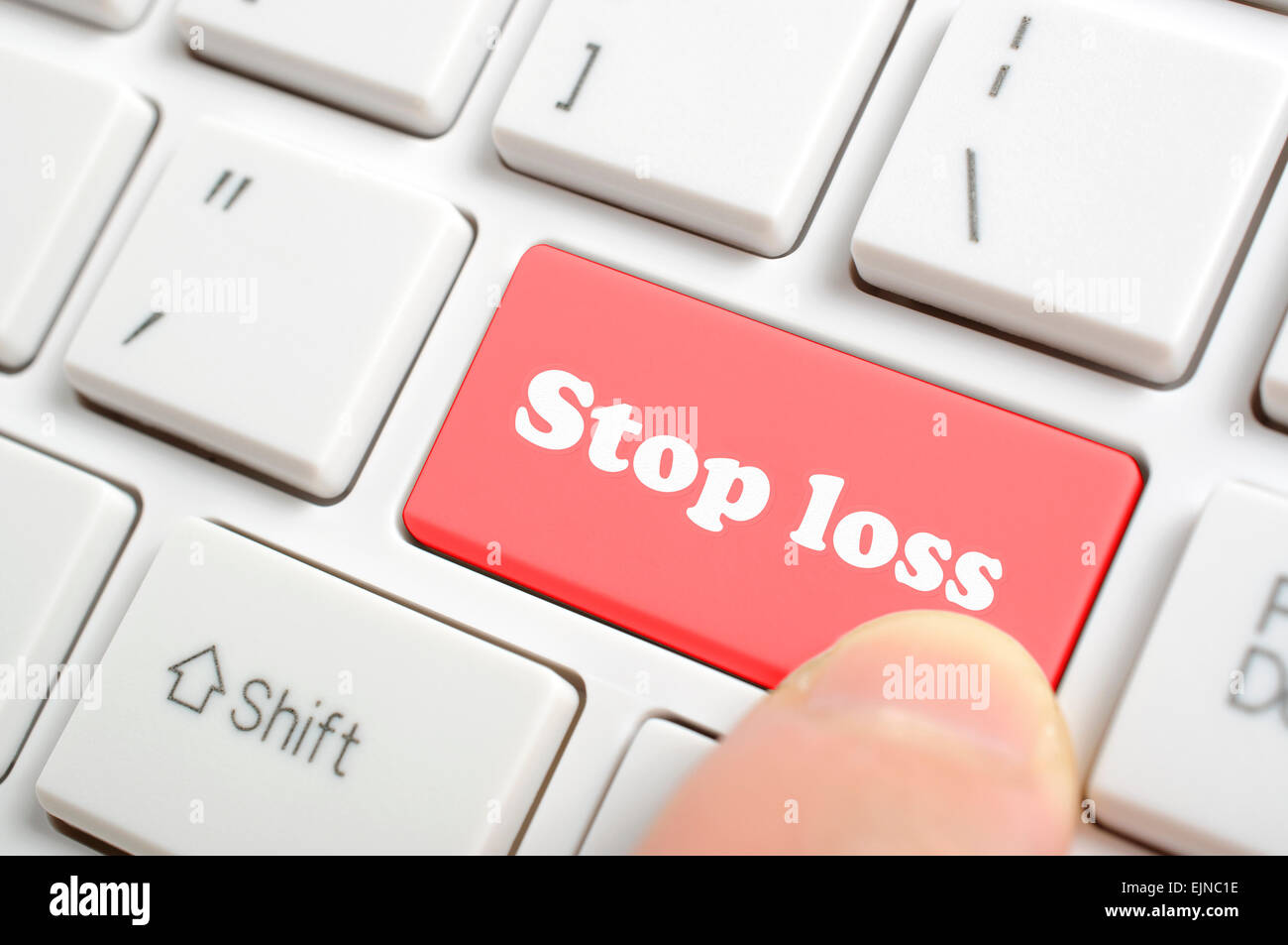 Pressing red stop loss key on keyboard - Stock Image