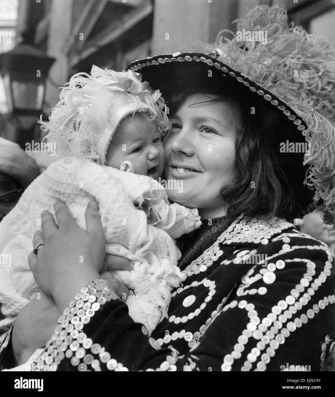Baby Kim O'Shea 2 months old, one of a long line of Pearly Kings and Queens was christened at St Martin's - Stock Image
