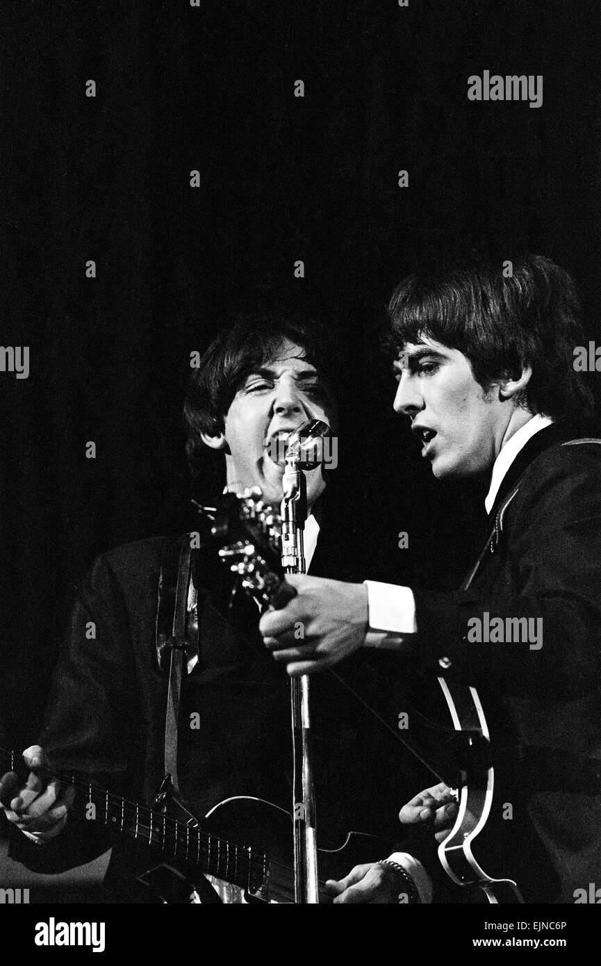 British pop group The Beatles performing on stage in Las Vegas during their visit to the USA. Paul McCartney and Stock Photo