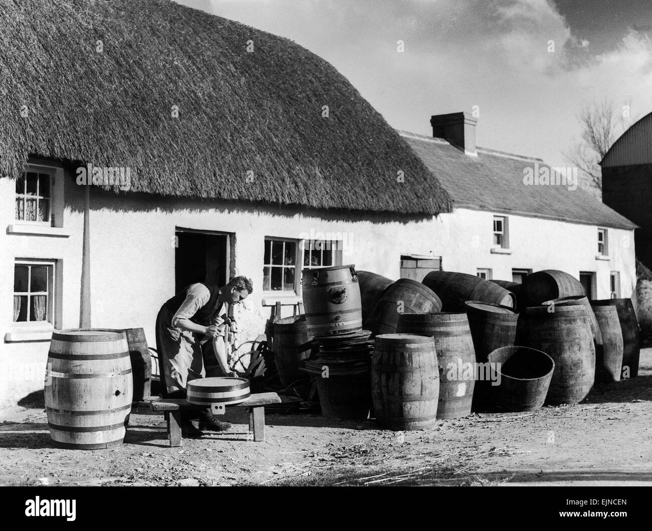 Richard Wadding seen here at work at the cottage cooperage at Killinick in County Wexford . The business consists - Stock Image