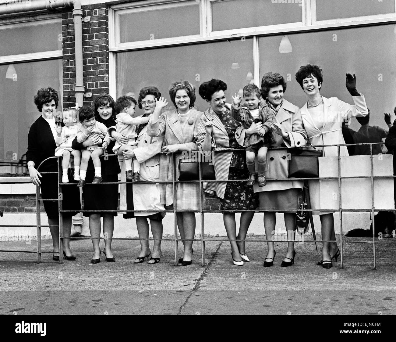 Wives and girlfriends of the Everton football team wave their last goodbye as the plane taking them off to Australia - Stock Image