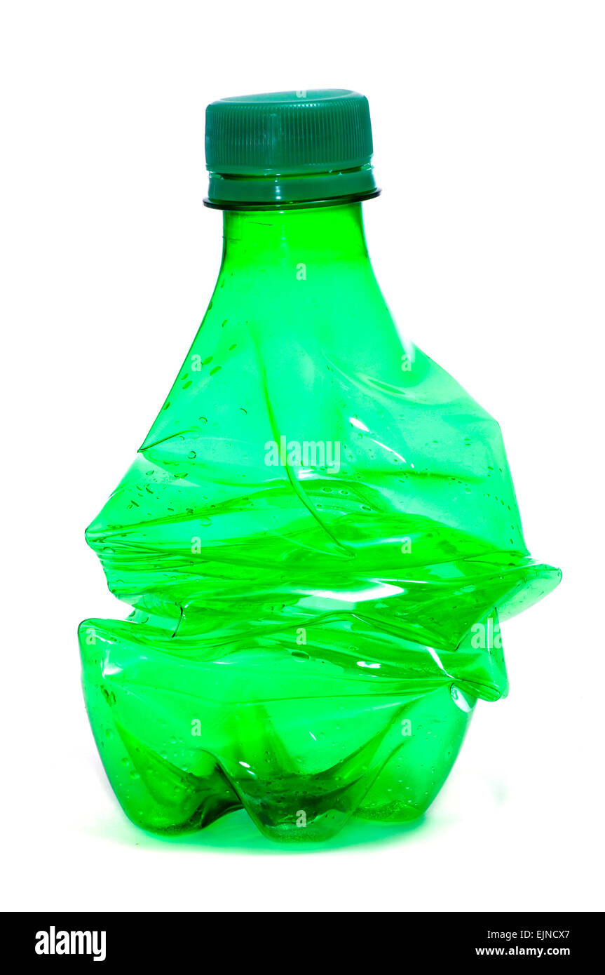 smashed green plastic bottle, on a white background - Stock Image
