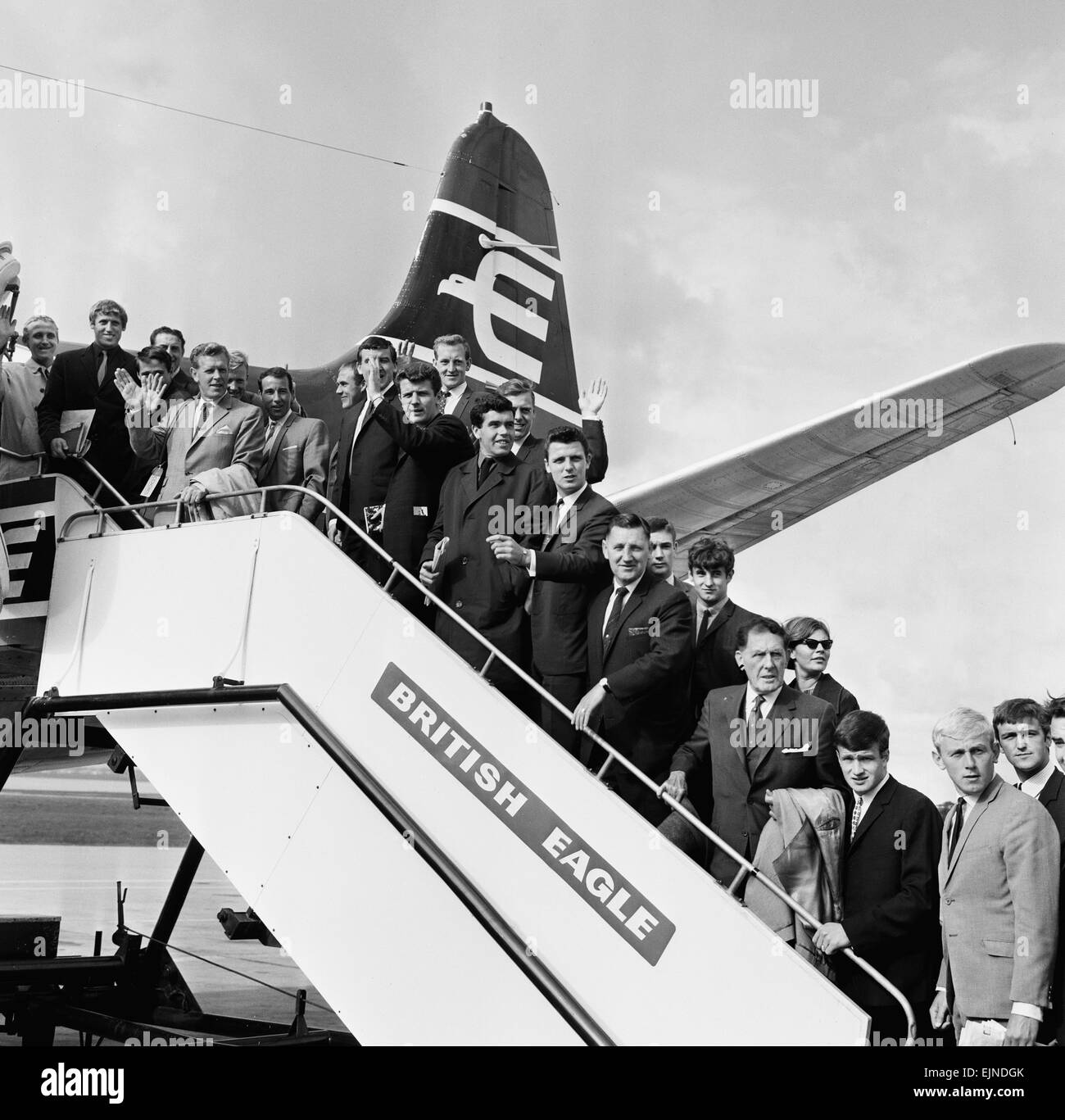 Everton team members wave from their plane before departing Speke airport, Liverpool for Oslo for a pre season warm Stock Photo