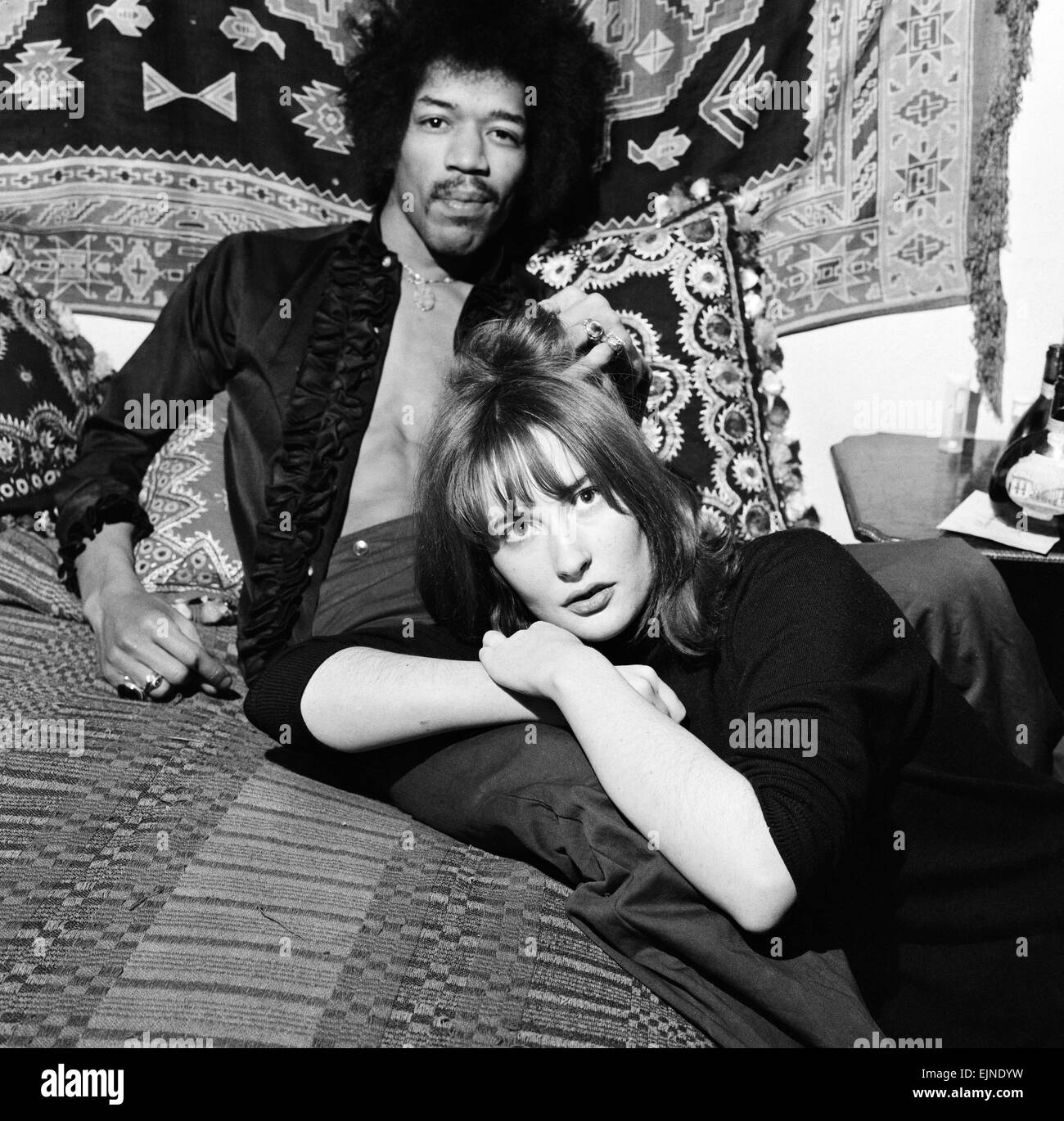 American singer and guitarist Jimi Hendrix with girlfriend Kathy Etchingham in his Mayfair flat, London. 7th January Stock Photo