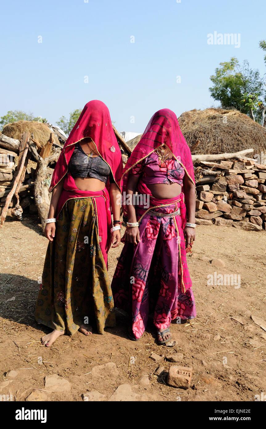 Two Rajasthani women girls wearing traditional clothes kalpi tribal Village  Rajasthan India - Stock Image
