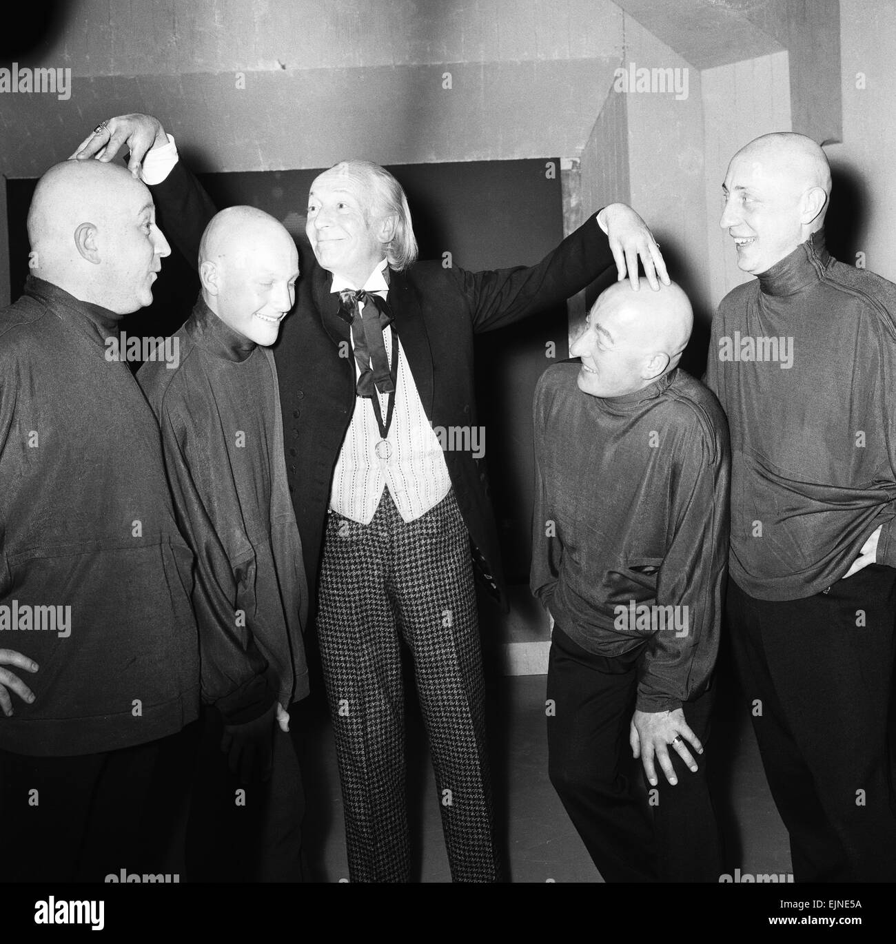 Beware ! These for cheerful young men are going bald headed for Dr Who. When they appear on screen they will not Stock Photo
