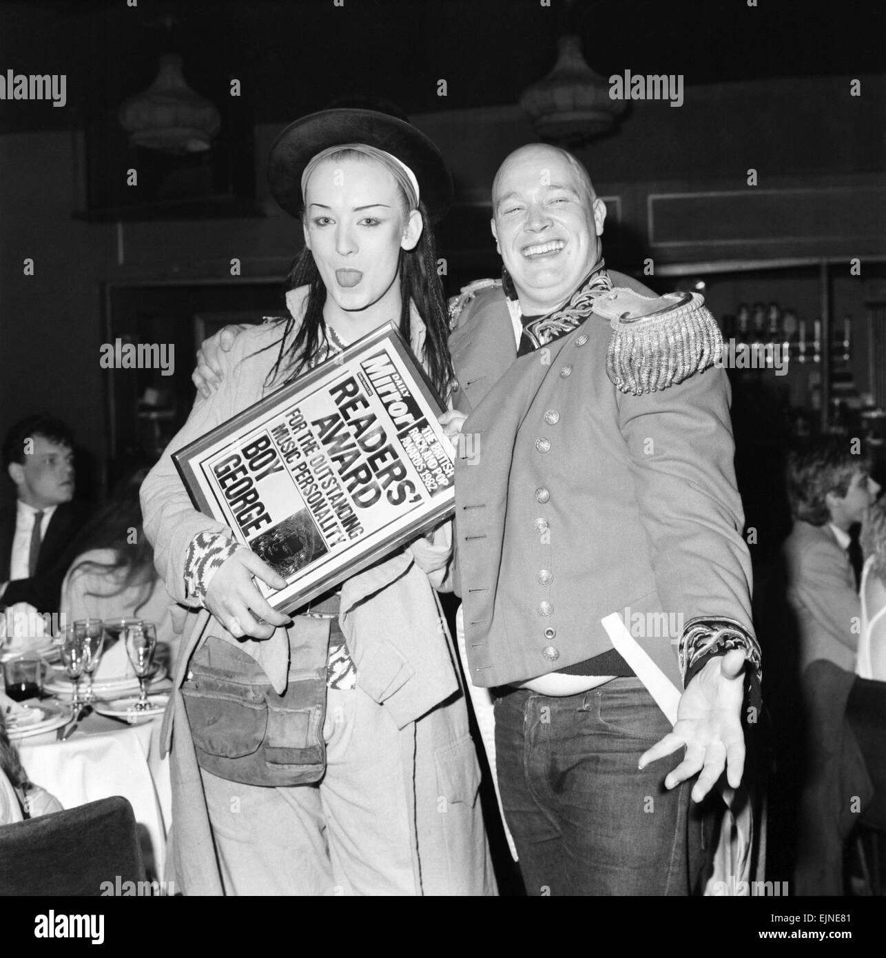 British Rock and Pop award at London's Lyceum ballroom. Singer of the group Culture Club Boy George celebrates after Stock Photo