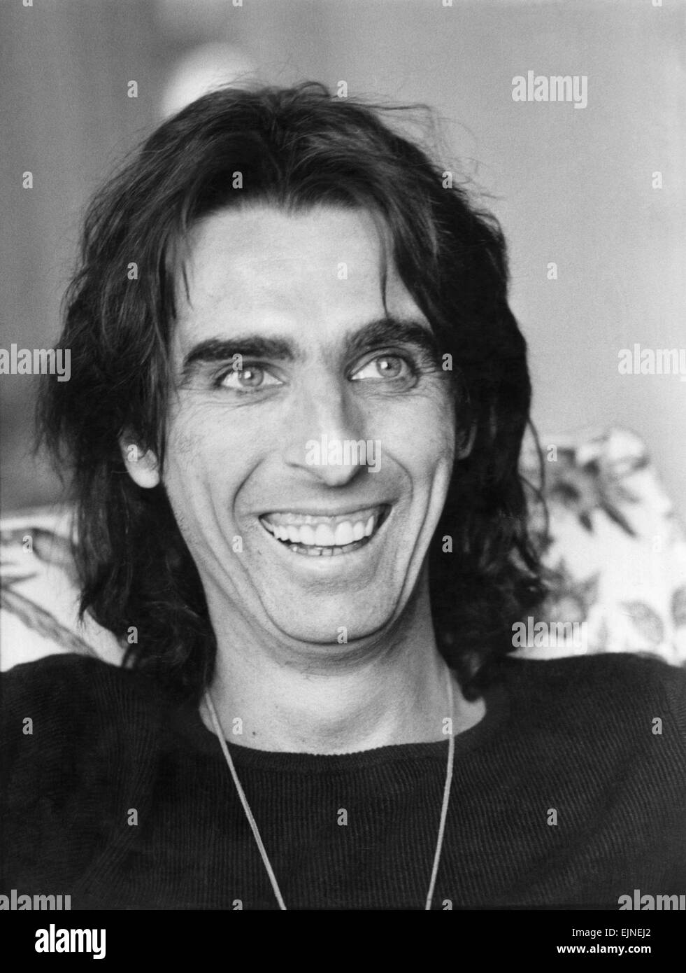 Pop star Alice Cooper talks to Pauline McLeod at the Savoy hotel. March 1978. - Stock Image