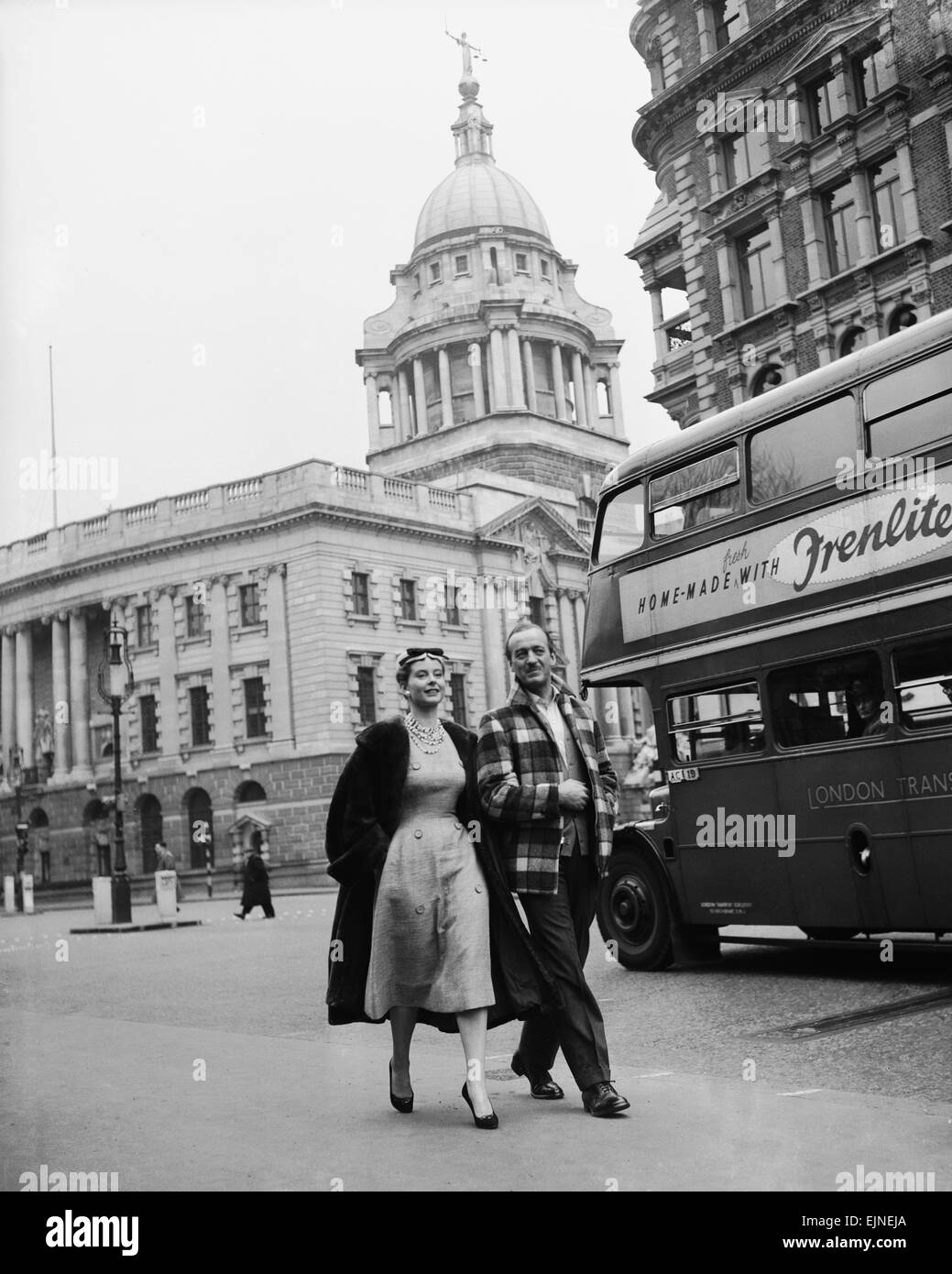 Actor David Niven with French actress Genevieve Page walking through London during a break from filming on their Stock Photo