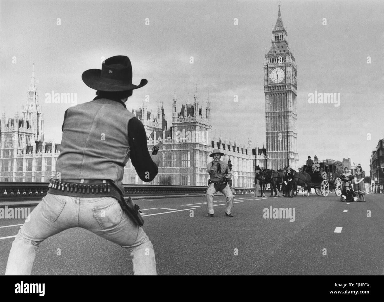 High Dawn in the West (Minster): This shoot took place on WestMinster Bridgre this morning at Dawn. A dozen cowboys - Stock Image