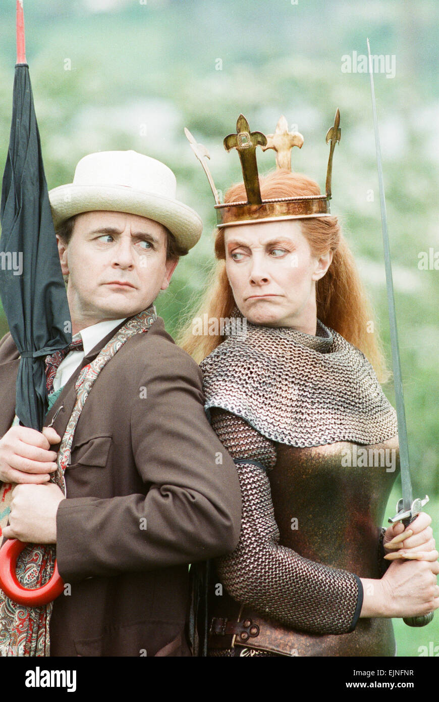Sylvester McCoy as the Doctor with Jean Marsh as Morgaine whilst on location filming for the Dr Who story Battlefield. - Stock Image