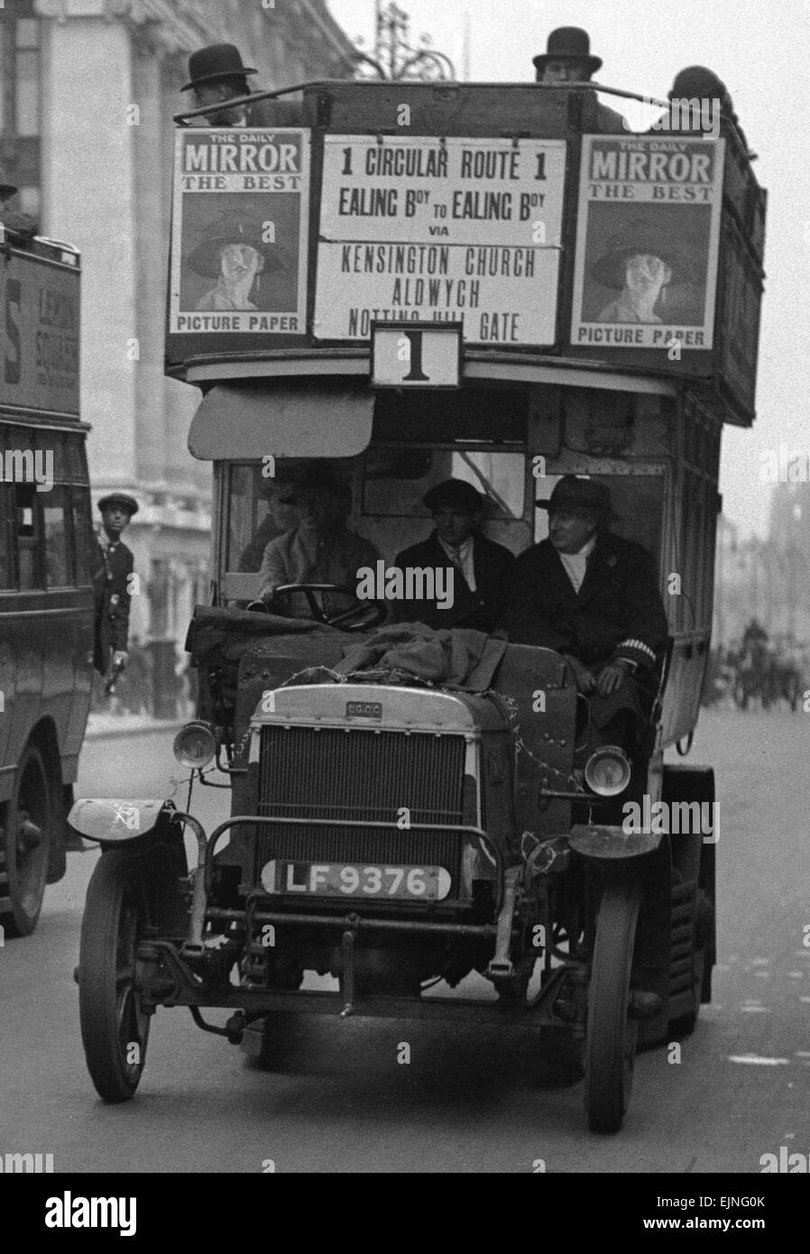 Buses driven by volunteers seen here in Oxford Street during the 10th day of the General Strike. The police escort Stock Photo