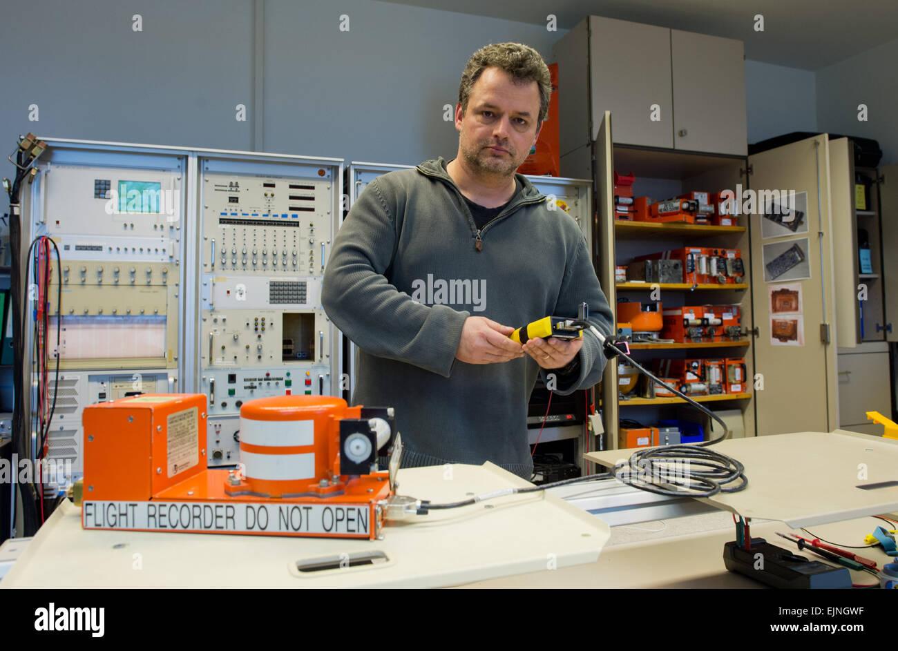 Braunschweig, Germany. 30th Mar, 2015. Jens Friedmann shows a flight recorder at the German Federal Bureau of Aircraft Stock Photo