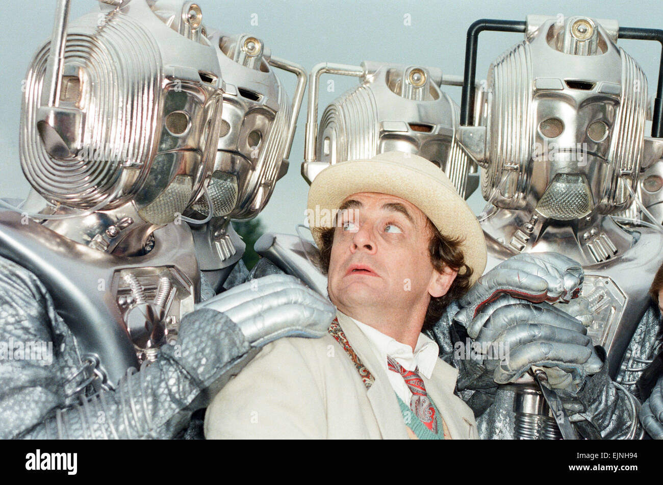 Sylvester McCoy as the Doctor seen here on location near Arundel with the Cybermen during the filming of the Dr - Stock Image