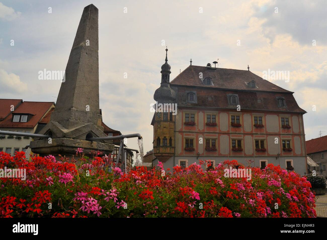 Fountain and town house in old center, Koenigshofen, Germany - Stock Image
