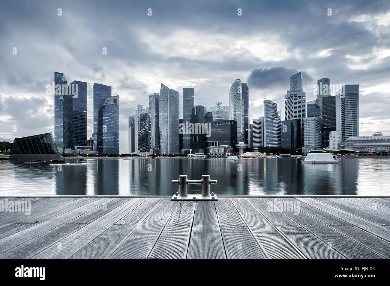 Singapore city skyline seen from the pier - Stock Image