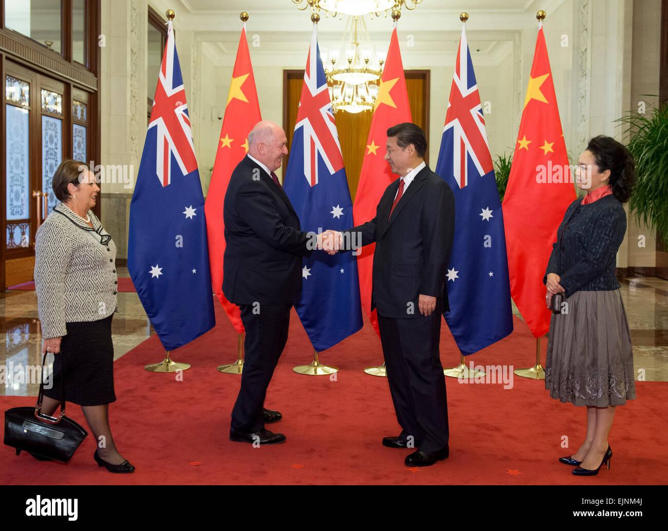 Beijing, China. 30th Mar, 2015. Chinese President Xi Jinping (2nd R) and his wife Peng Liyuan (1st R) greet Australian - Stock Image
