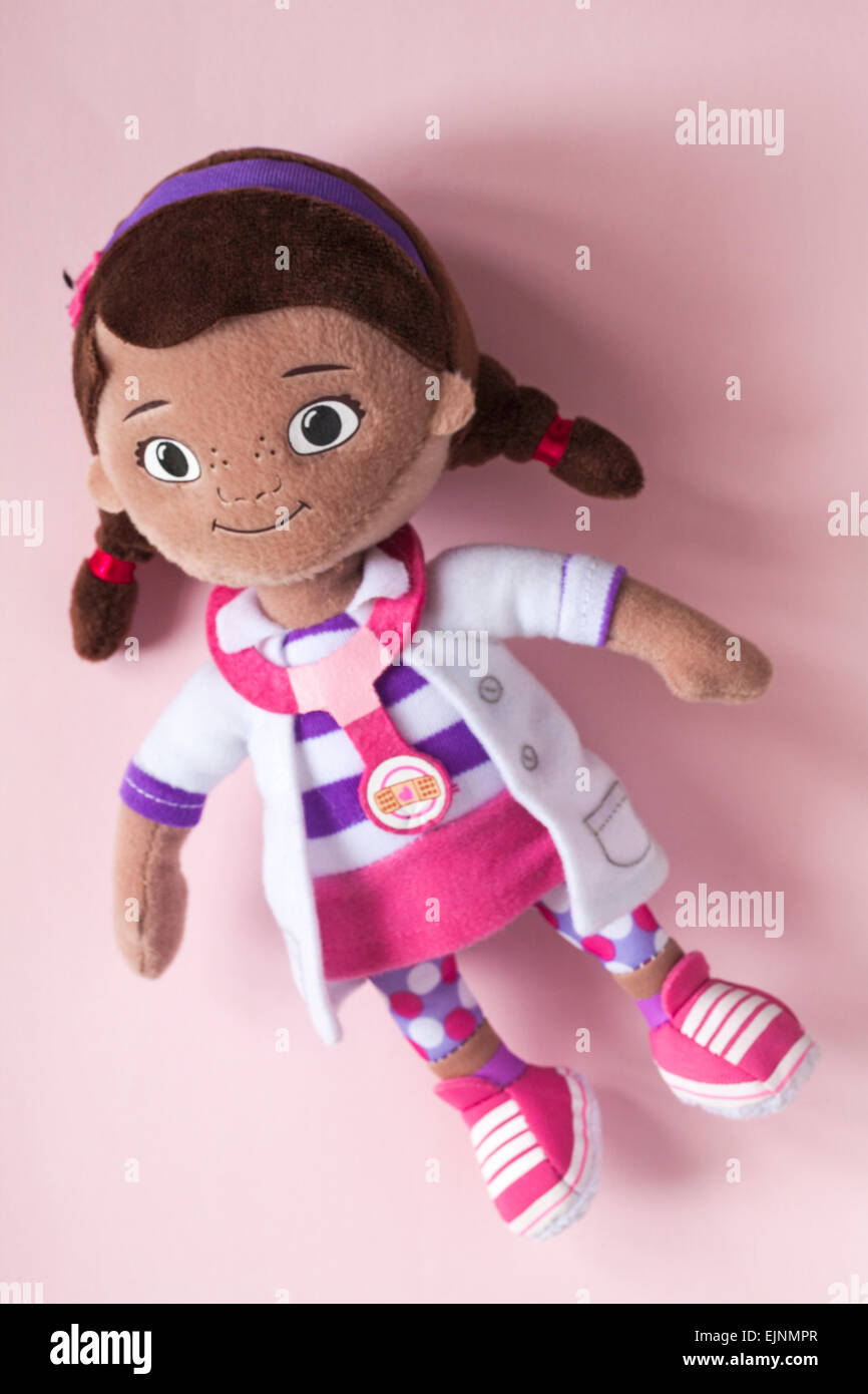 Doc Mcstuffins Posh Paws soft cuddly toy isolated on pink background - Stock Image