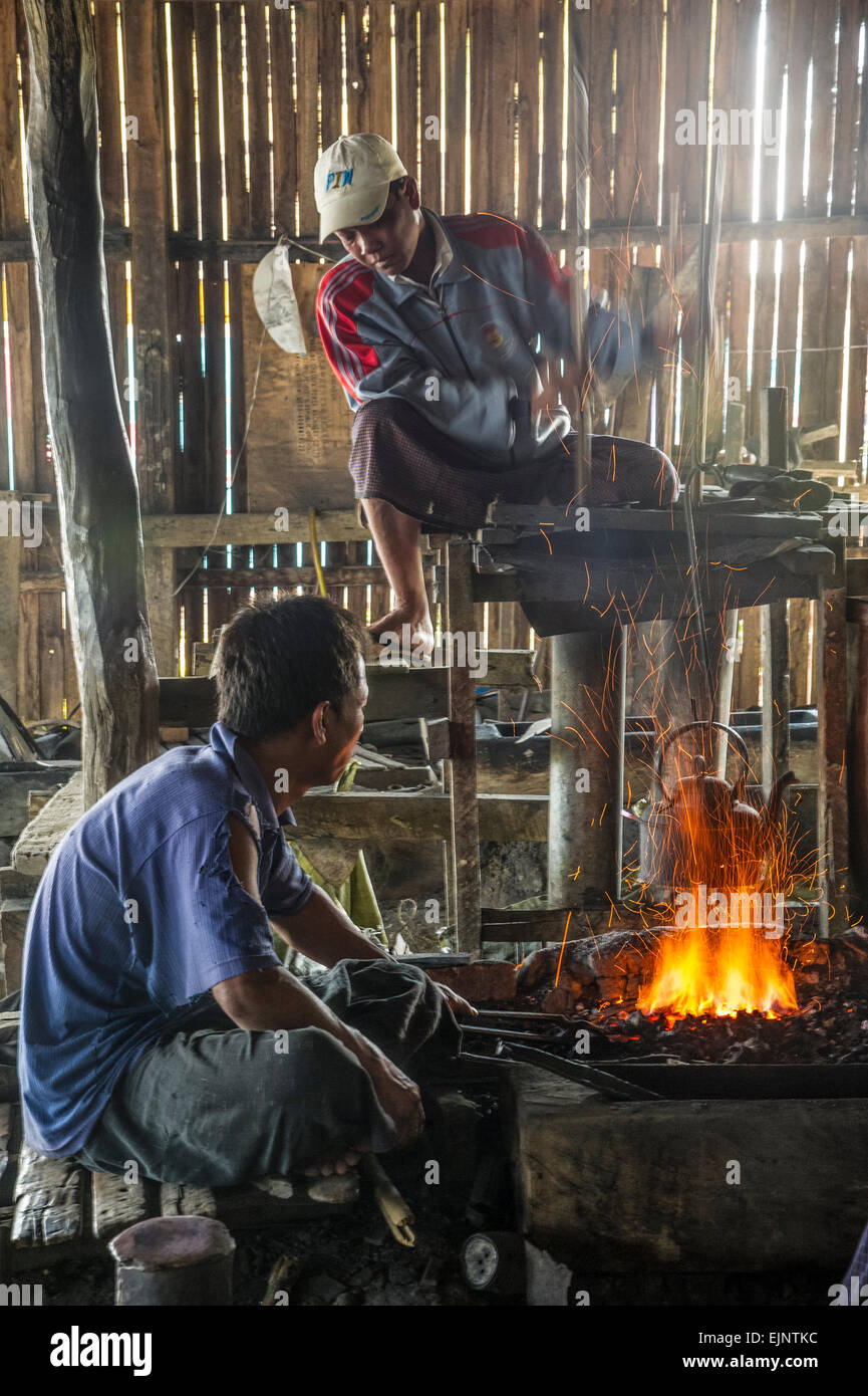 Scene from Inle Lake,  at the  blacksiths workshop - Stock Image