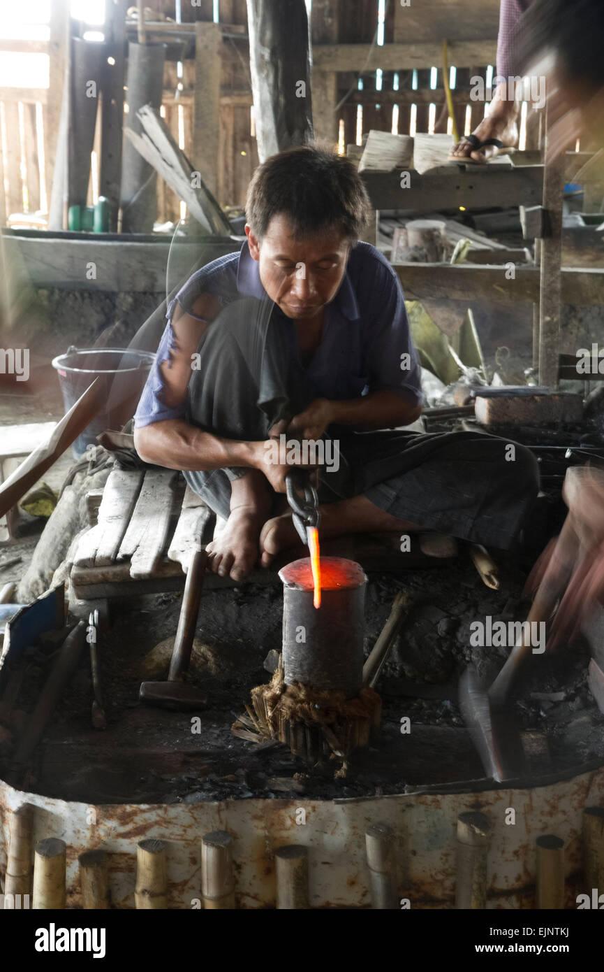 Scene from Inle Lake,  at the silk weavers workshop  blacksmiths workshop - Stock Image