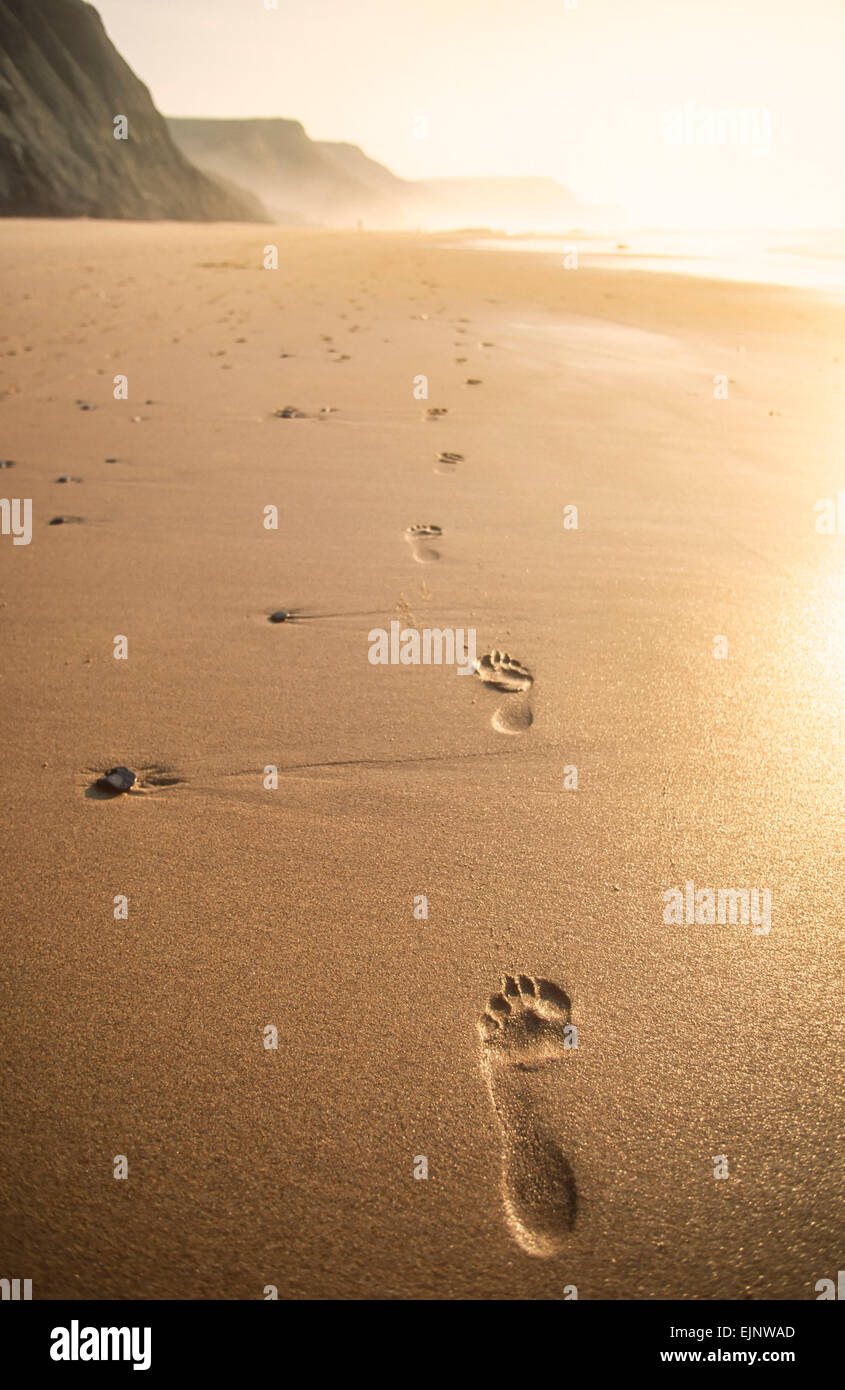 Footprints in sand Castelejo Beach Algarve Portugal EU Europe - Stock Image