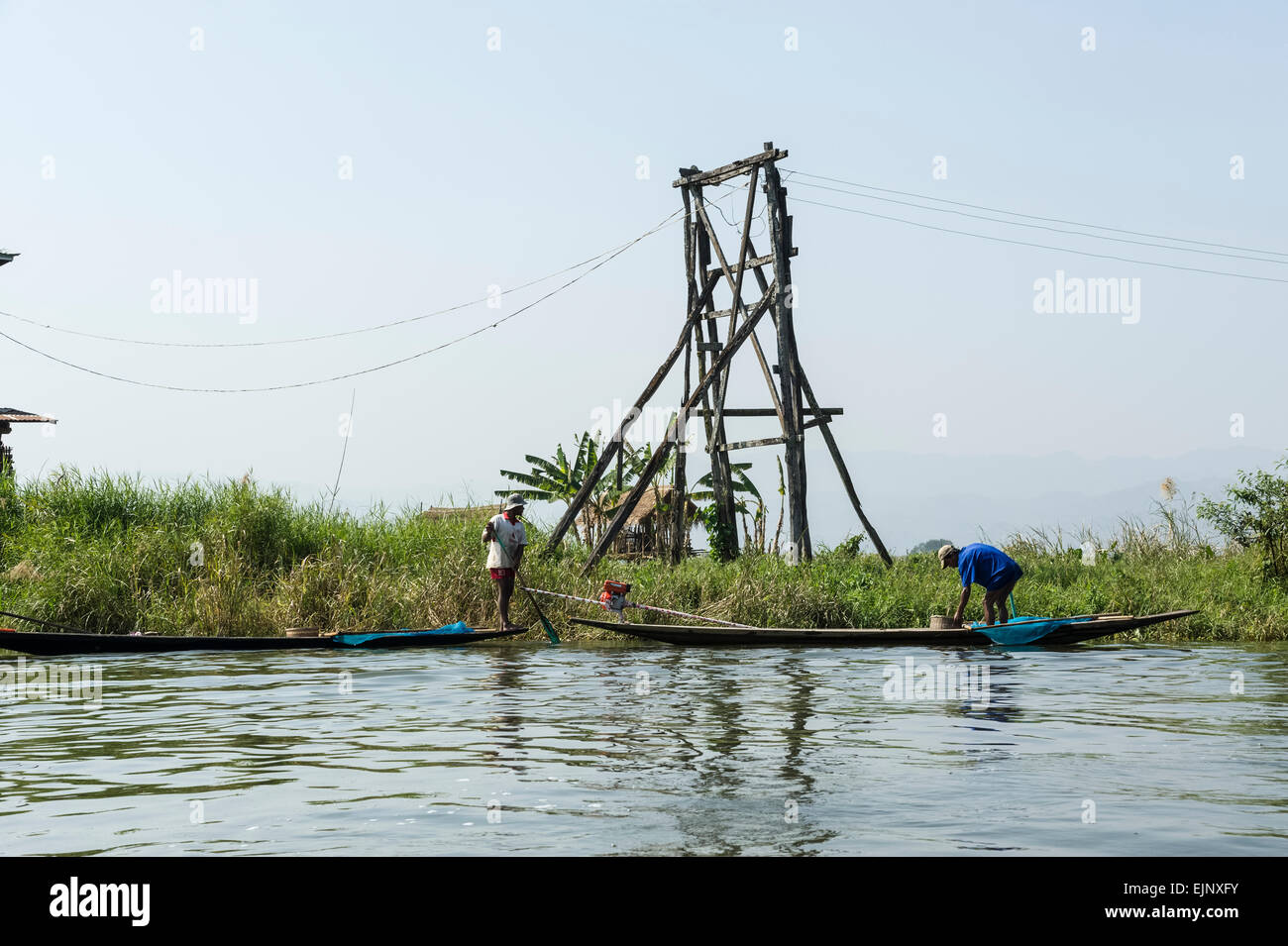 Scenes on Inle Lake, note the electricity pylon - Stock Image