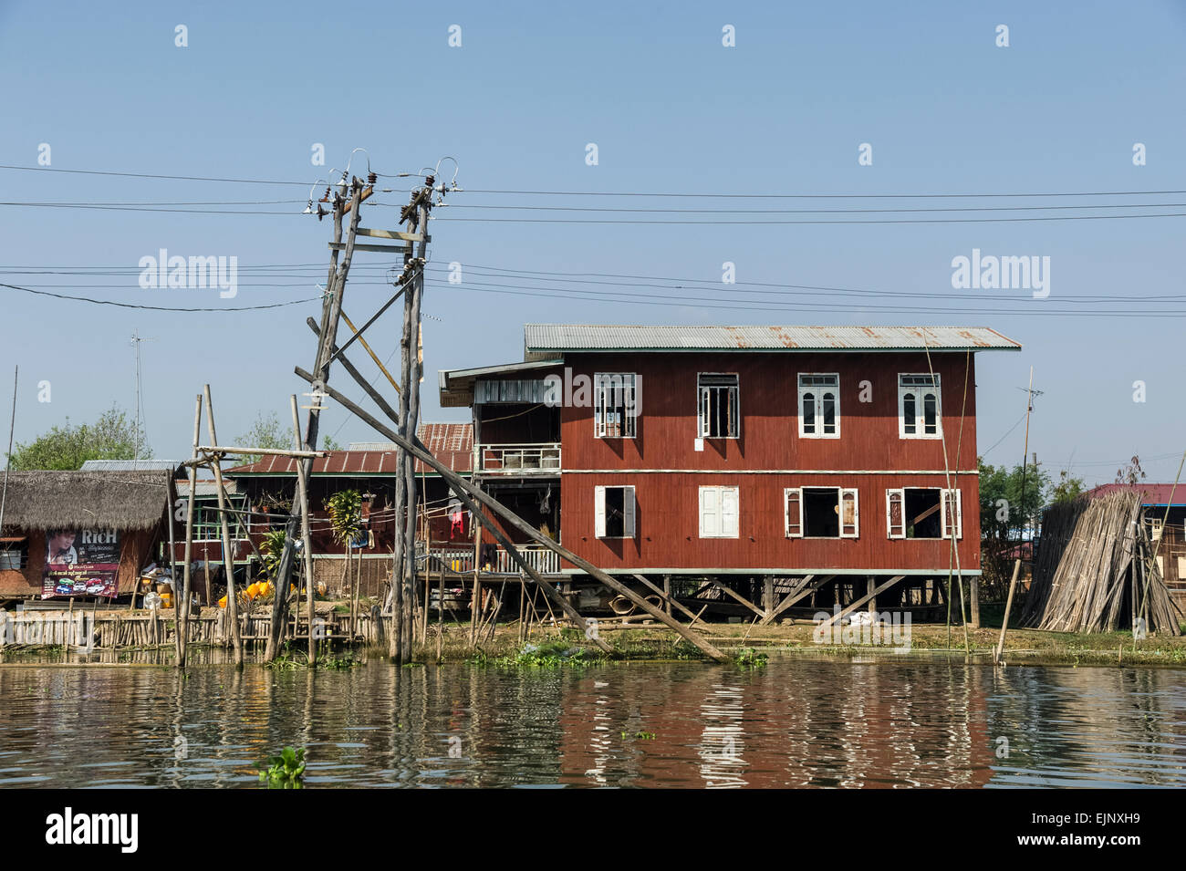 Scene from Inle Lake, stilt houses, note the electricity pylon - Stock Image