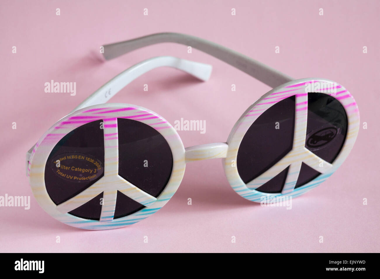 Sticker on sunglasses with peace symbols - tested to BSEN 1836 2005 Filter Category 3 Total UV Protection - Stock Image