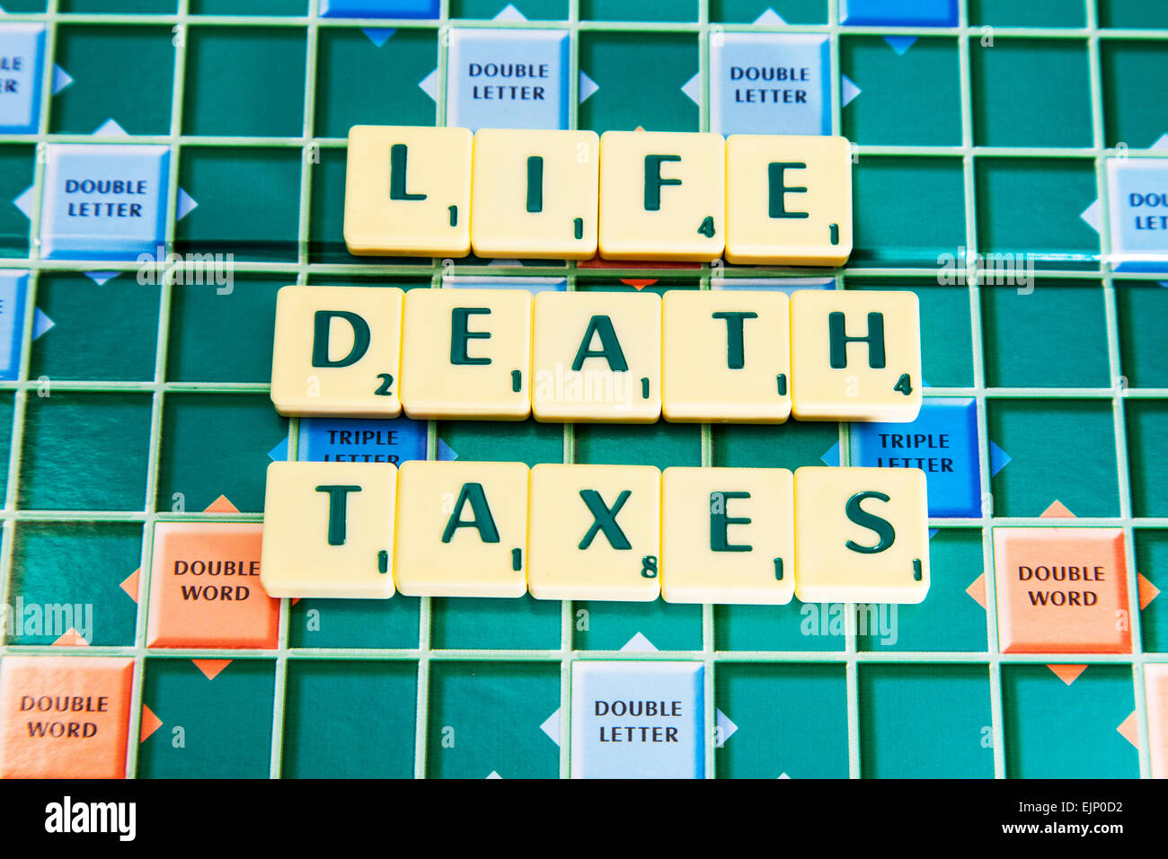 life death taxes only 3 things to be sure of in words using scrabble tiles to illustrate spelling spell out - Stock Image