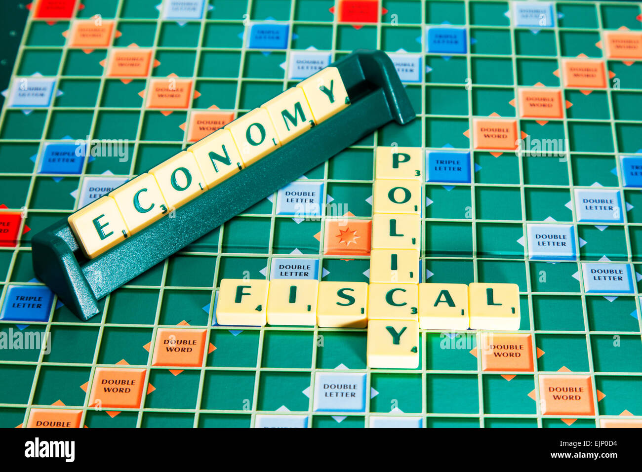 fiscal policy economy government election tax vat taxes raising words using scrabble tiles to illustrate spelling - Stock Image