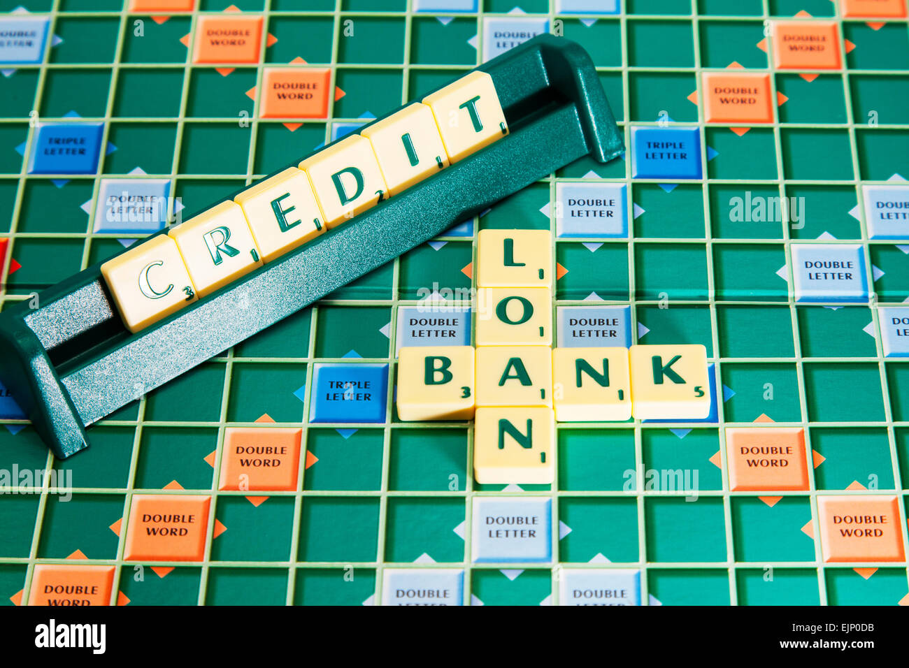 bank loan credit loans debt debts words using scrabble tiles to illustrate spelling spell out - Stock Image