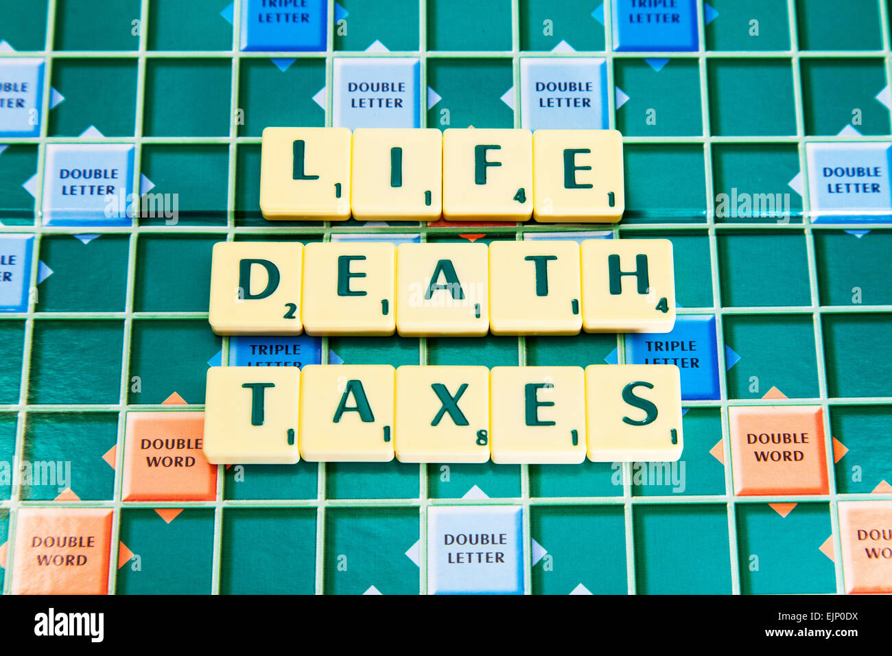 life death taxes only 3 things to be sure of in life words using scrabble tiles to illustrate spelling spell out - Stock Image
