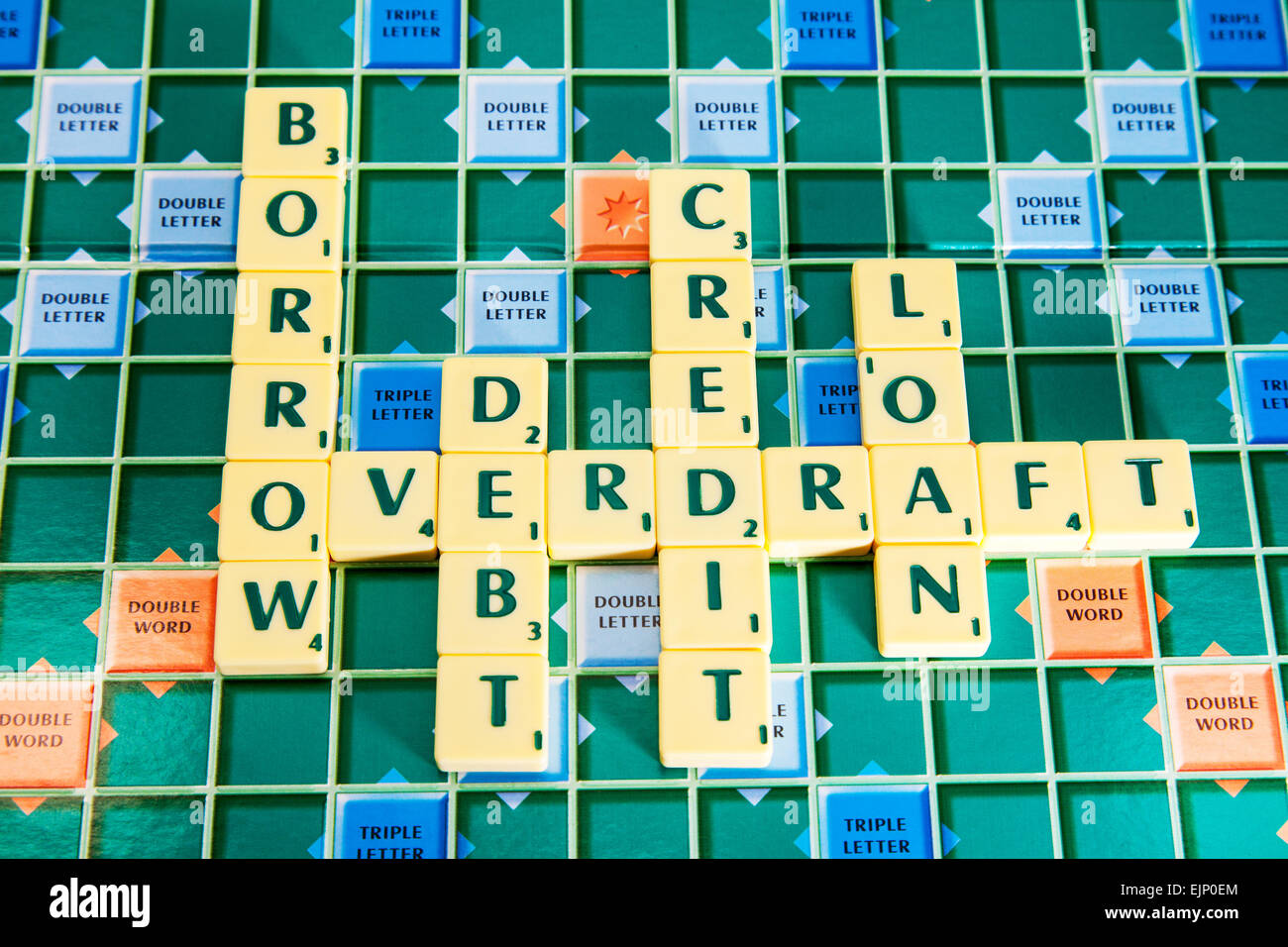 credit loan overdraft borrow debt borrowing debts loans cards card words using scrabble tiles to illustrate spelling - Stock Image