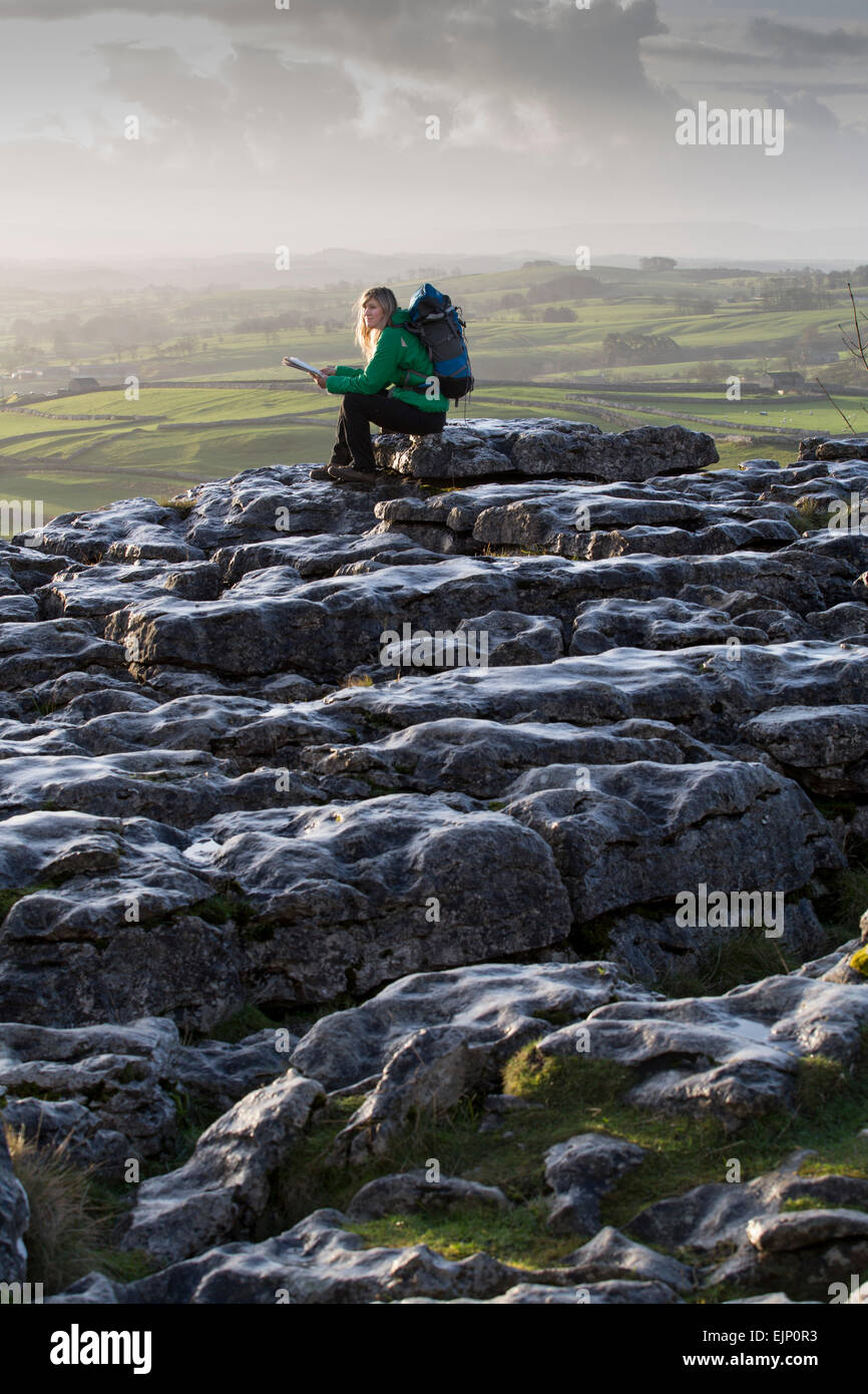 Malham Cove , North Yorkshire UK - Limestone pavement on top of Malham Cove with fine views down Malhamdale - Stock Image